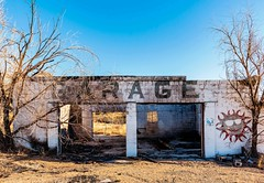 Garage, Organ, New Mexico (garshna) Tags: garage window doorway trees sky abandoned ruins