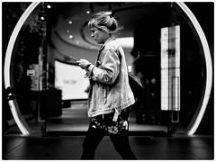 Discovery store (gro57074@bigpond.net.au) Tags: woman oasis ovalentrance cbd sydney pittstreetmall discoverystore highcontrast candid 50mmf14 artseries sigma d850 nikon street streetphotography futuristic monochrome blackwhite bw