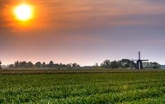 The unstoppable setting of the sun. (Alex-de-Haas) Tags: 70200mm adobe d500 dutch hdr holland lightroom nederland nederlands netherlands nikkor nikon nikond500 noordholland oudesluis photomatix photomatixpro schagerbrug beautiful beauty drama dramatic landscape landschaft landschap lente lucht mill molen mooi nature natuur orange oranje peaceful polder skies sky skyscape spectaculair spectacular spring sun sundown sunset vredig zonsondergang