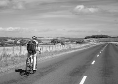 The open road (2slo7) Tags: cyclist road quiet light distance rural day shadow moving sky clouds
