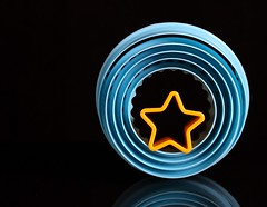 Circles-Star (Karen_Chappell) Tags: blue black yellow stilllife round circle star plastic shapes