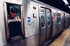 E Train. (Livia Lopez) Tags: newyorkcity subway timessquare photography train canon man manhattan conductor 18mm transportation