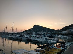Sunset behind the rock (thomas.bee72) Tags: sunset spain boats harbour clear sky evening coast town