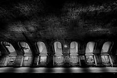 Baker Street (heinzkren) Tags: london tube station schwarzweis blackandwhite bw sw monochrome panasonic lumix urban building bahnhof gare ziegel light magic mystery geometry shadow object city platform bahnsteig underground ubahn bricks gewölbe vault dome arch urbanarte gb empty tunnel seven windows pattern texture uk