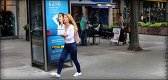 `2383 (roll the dice) Tags: london urban england streetphotography classic art uk unaware unknown canon tourism tourists surreal reaction danger mad sad fun funny shock people fashion portrait stranger candid speed crowd rush blur nw3 hampstead belsizepark camden phone advertising pretty sexy girl blonde double twins westernunion lunch eat shops shopping jeans box wave smile happy mobile talk