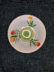 Where's the tea? (jblu3488) Tags: flowers glass plate teacup tea light red blue white yellow pink green