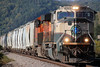 BNSF 9656 (Western WI Rail Images) Tags: bnsf locomotive sky sun train clouds grass rocks bn executive unit cream green sand loads
