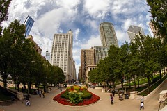 Millennium Park (Karen_Chappell) Tags: travel park chicago usa illinois fisheye canonef815mmf4lfisheyeusm wideangle city urban downtown cityscape architecture buildings people trees flowers sky blue green red nature rgb colourful colours colour color scenery scenic landscape