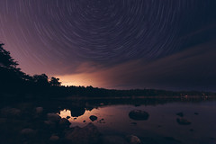 Midnight Dream (Bunaro) Tags: uutela vuosaari helsinki suomi finland europe night midnight glow light pollution star trails composite longexposure waterscape landscape 1635l28