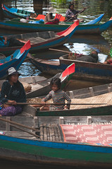 Siem Reap Floating Market (Syahrel Azha Hashim) Tags: nikon siemreap boats shallow holiday simple editorial details transportation local kampongphluk dof 50mm asia boat getaway handheld humaninterest colorimage vacation 2015 prime light culture naturallight people colorful floatingmarket d300s river paddle fishermenvillage wodenhouse colors syahrel cambodia woodenboat travel detail