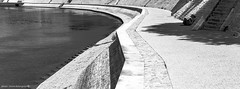 Rhone's embankment in Arles (hervedulongcourty) Tags: 123bw photo france embankment berges city summiluxm35mmf14asph eataly fleuve panoramic rhône panoramique rives ombre nb bank m9 streetbnw summer provence noiretblanc monochrome river photography summilux leicam blackandwhite leicalenses bw arles streetphotography leica ngc