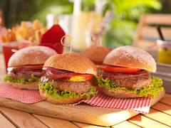 Gingham and ground beef (StephenCaissiePhoto) Tags: summer barbecue burgers food sunlight frenchfries gingham napkins red tomatoes lettuce beef warm poolside patio commercial phaseone p30 captureone shallowdof proimaging condiments mouthwatering