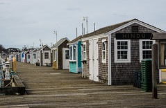 Harmoniously in a row (Rabican7-AWAY) Tags: newengland provincetown huts wood pier port colorful linedup depth texture ptown dock city town urban coastal blue sky massachusetts