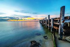 Now it's just a dream († David Gunter) Tags: seascape waterscape landscape edited gimp painterly dreambeach ocean bay sea water sand sky clouds pier warf
