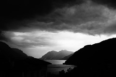 It's getting uncomfortable (stefankamert) Tags: stefankamert dark clouds storm lake mountains lakecomo comersee italy bellagio blackandwhite blackwhite noir noiretblanc sony rx1 rx1r fullframe zeiss 35mm mirrorless