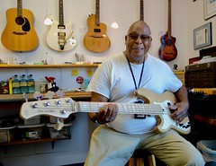 Big John Howard picking up his new lefty Fender Marcus Miller Bass after having me set it up righty.....so very cool, (David Neely) Tags: guitars bass fender