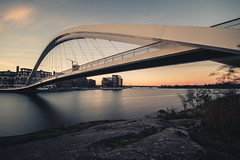 Grandfather's Bridge (Bunaro) Tags: kalasatama mustikkamaa helsinki myhelsinki finland visitfinland suomi suomi100 europe bridge engineering architecture autumn evening night sunset longexposure orange yellow waterscape seascape landscape cityscape water sea ocean grandfather art smooth