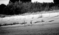 At fishing (georgeunum) Tags: handheld exa1c 3m5amc500mmf8 children fishing sunny water wind bw adoxadonal foma100iso fomafix 1100 17minepsonperfection3170photo 3m5amc 500mm exa 1c f8 maksutov mirror foma 100 iso adox adonal 17min 21 degrees c forest