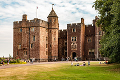 Dunster Castle (Keith in Exeter) Tags: castle dunster exmoor nationalpark nationaltrust building architecture fortified tower castellation gradei listed scheduled monument grass people tree sky flag