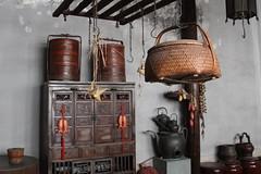 杭州西湖-胡雪巖故居 (沐均青) Tags: china landscape scenery travel brown 杭州 buildings furniture basket 竹籃 cupboard red gold fish kitchen teapots
