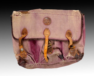 A well worn, faded, and used Leica camera bag from the 1970s.
