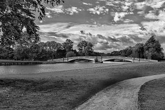 A scenic view!😊👍😊 (LeanneHall3 :-)) Tags: blackandwhite mono bridge field lake sky skyscape grass clouds talkativeclouds cloudsstormssunsetssunrises eastpark hull kingstonuponhull landscape canon 1300d groupenuagesetciel
