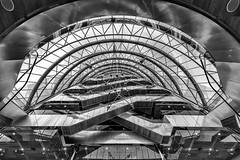 Céad Míle Fáilte (Leipzig_trifft_Wien) Tags: dublin countydublin irland ie architecture wideangle lookup lookingup blackandwhite bnw bw black white ecalators inside round modern glass contemporary grey structure steel contrast