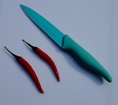Red and Green #2. (ianmiller6771) Tags: 2 colours greenandred fujixe2 knife chillies abstract
