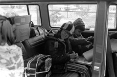 020471 13 (ndpa / s. lundeen, archivist) Tags: nick dewolf nickdewolf blackwhite blackandwhite 35mm film photographbynickdewolf bw february 1971 1970s boston massachusetts beaconhill mtvernonsquare people vw volkswagen bus microbus luggage bags box windows child children kids girl boy coat coats hat hood nicole glasses eyeglasses quentin stripedpants