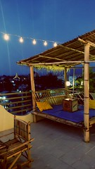 Enjoying a drink at dusk, no better place than a rooftop to contemplate the quiet southeast asian town Rooftop bar @ Ostello Bello Inlay lake