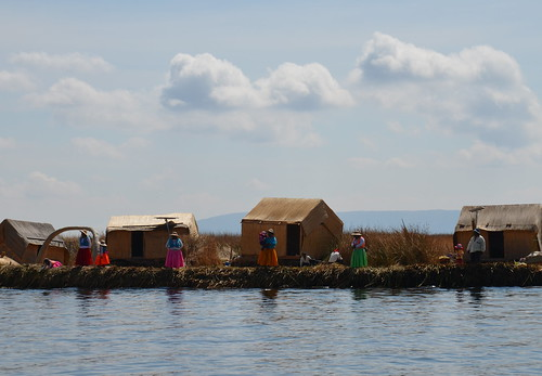 Standing in line, floating islands, Lake Titicaca