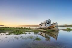 Point Reyes shipwreck (AkDExplorer) Tags: california pointreyes inverness shipwreck nikon d850 hoya breakthroughfilter benro acratech bayarea sanfrancisco northernbay reflection serene bluesky clearsky boat laowa