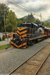 GSMR GP9 1755 at Dillsboro (Railroad Gal) Tags: gsmr gsmr1755 gp9 locomotive greatsmokymountainsrailroad greatsmokymountains northcarolina jacksoncounty swaincounty dillsboronc dillsboro brysoncitync passengertrain trainexcursion carhost appalachianmountains railroad railfan railfanning femalerailfan trainphotography emd train diesellocomotive thefugitive nantahalaoutdoorcenter fontanalake foliage mountains clouds landscape town