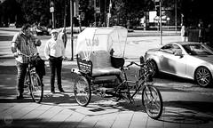 That way (dlerps) Tags: street streetphotography monochrome bw blackwhite lerps lerpsphotography daniellerps sony sonyalpha sonyalpha99ii sonyalphaa99ii carlzeiss carlzeissplanar50mmf14ssm bicycle riksha traffic men people