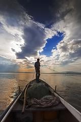 TEK (uzaktanbakanadam) Tags: landscape lake clouds colour ship boat light place hunter fisherman işıklı canon goldenhours ngc