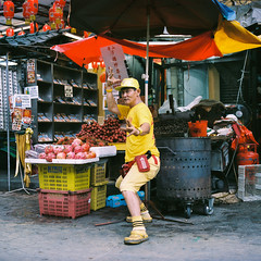 """Kung-Fu Master"" (Yeow8) Tags: fujifilmgf670 kodakportra400nc filmphotography filmphoto filmphotographer filmisnotdead filmcommunity ishootfilm filmstreetphotography streetphotography streetphotographer streetportrait streetportraitphotography portrait portraiture portraiturephotography chinatown petalingstreet kualalumpur malaysia roadsidestall fruitsstall colorfilmphoto myworkplace workplace beautifulstanger kungfumaster"