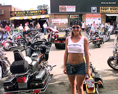 Aug 2001 - Lovely smile and more in downtown Sturgis (La_Z_Photog) Tags: lazy photog elliott photography don hall sturgis south dakota motorcycle rally broken spoken saloon babes beer bikes