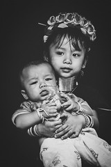 - (tommasocroce) Tags: thailand travel asia karen chiangrai tribe longneck rural tradition siblings sister brother baby toddler