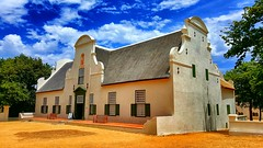 groot constantia house in cape town (heatgirlrvd) Tags: sea blue water church cape town spice route travel trees road dreams sand beach house rocks wine vineyard clouds sky