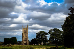 Cloudy day... (MickyFlick) Tags: clouds cloudyday mickyflick churchofstmarythevirgin titchmarsh churchtower village scenic titchmarshvillage eastnorthants northamptonshire england uk roseoftheshires yewtrees churchyard