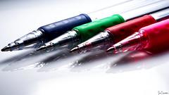 The Pen Is Mightier Than... (Ian Charleton) Tags: macromondays multicolor pens pen ballpoint writing macro written word red green blue pink whitebackground closeup