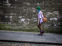 Uphill (Leanne Boulton) Tags: urban street candid streetphotography candidstreetphotography candidportrait streetlife woman female girl face walking profile uphill steep climbing boots colourful beanie blue hairstyle wall moss pavement sidewalk tone texture detail naturallight outdoor light shade city scene human life living humanity society culture lifestyle fashion style canon canon5dmkiii ef2470mmf28liiusm color colour edinburgh scotland uk