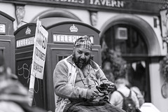 Telephone man_MG_6487 (ronniefleming@btinternet.com) Tags: telephone portrait streetportraiture candid edinburgh thefringe blackandwhite rawstreetphotography ph31fy ronniefleming smile tartan royalmile tattootickets signs glasses mobilephone people bw portraiture street