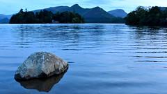"""A still evening"" (42jph) Tags: derwentwater keswick lake district cumbria uk england nikon d7200 water evening twilight rocks catbells hills mountains"