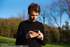 working Digital (GemmaTi_phd) Tags: sempreconnesso digital generation ragazzo portrait people parco primopiano cellulare onthenet sunlight spring