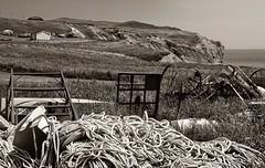 Better Junk at the Precipice (nelhiebelv) Tags: wrecked scenic coastline entry island quebec farm equipment rope monotone