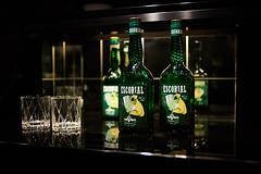 Would you like a drink? (iamunclefester) Tags: münchen munich drink bottle green shopwindow shop glass mirror dark street black cupboard liqueur escorial flambé onice ice