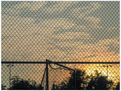 Fenced In (prima seadiva) Tags: clouds dusk evening fence millerpark sunset