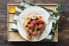 Belgian waffles with honey and raspberries for breakfast (Arx0nt.) Tags: waffle breakfast berry belgian honey delicious raspberries dessert food fresh fruit raspberry sweet tasty topview yummy baked blueberry flower crispy pastry snack wafer homemade mint gourmet square background healthy morning red white closeup wooden colorful traditional leaf cake golden butter maple lunch strawberry syrup summer sugar peach texture waffles above
