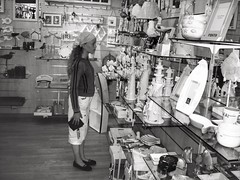 So much to choose from ... (LUMEN SCRIPT) Tags: france noirmoutier giftshop gifts souvenirs shop candid streetphotography street monochrome